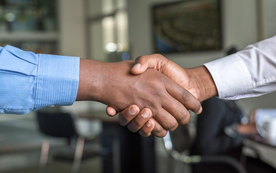 two people shaking hands